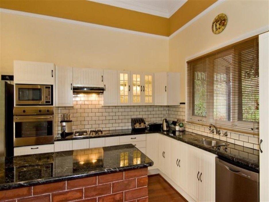 Kitchen Nice Looking Kitchen Idea Using White L Shaped From Red Brick  Backsplash Kitchen