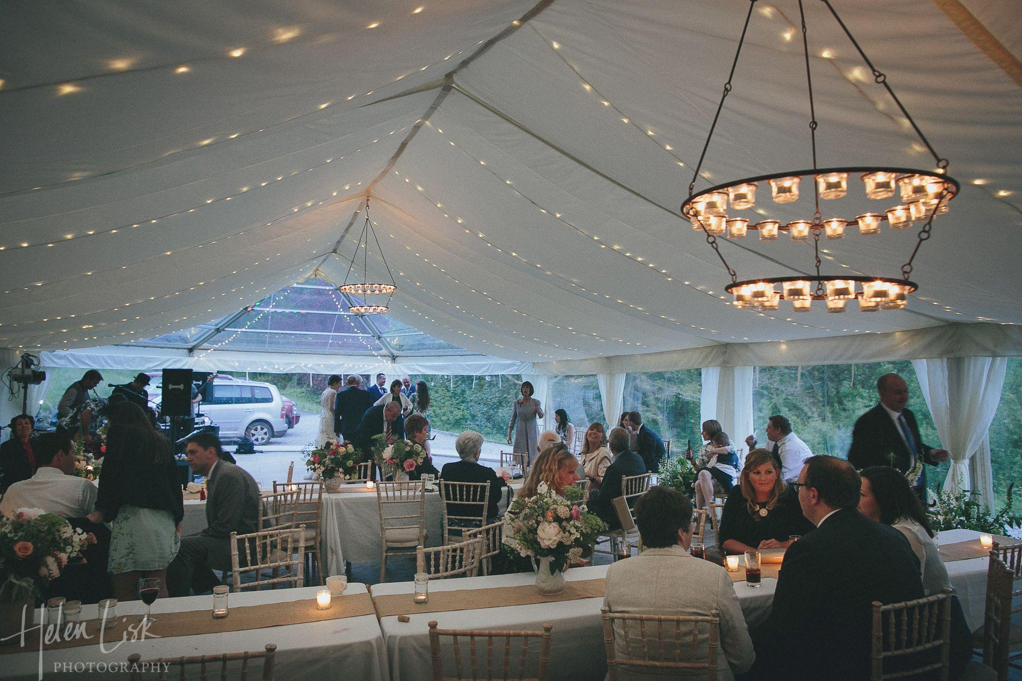 Wedding marquee with festoonfairy lights behind flat roof linings wedding marquee with festoonfairy lights behind flat roof linings and hanging tea light chandeliers arubaitofo Gallery
