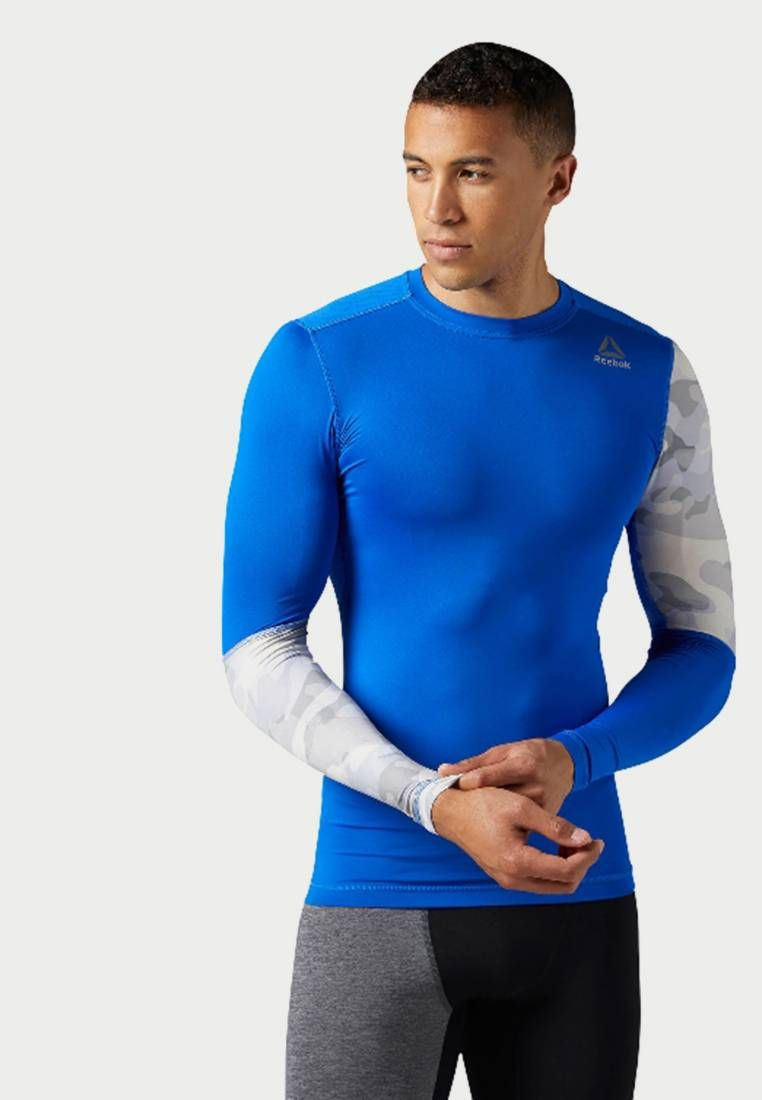 f71dbfb0e1e0 Reebok. Sports shirt - blue. Fit Tailored. Outer fabric material 86 ...