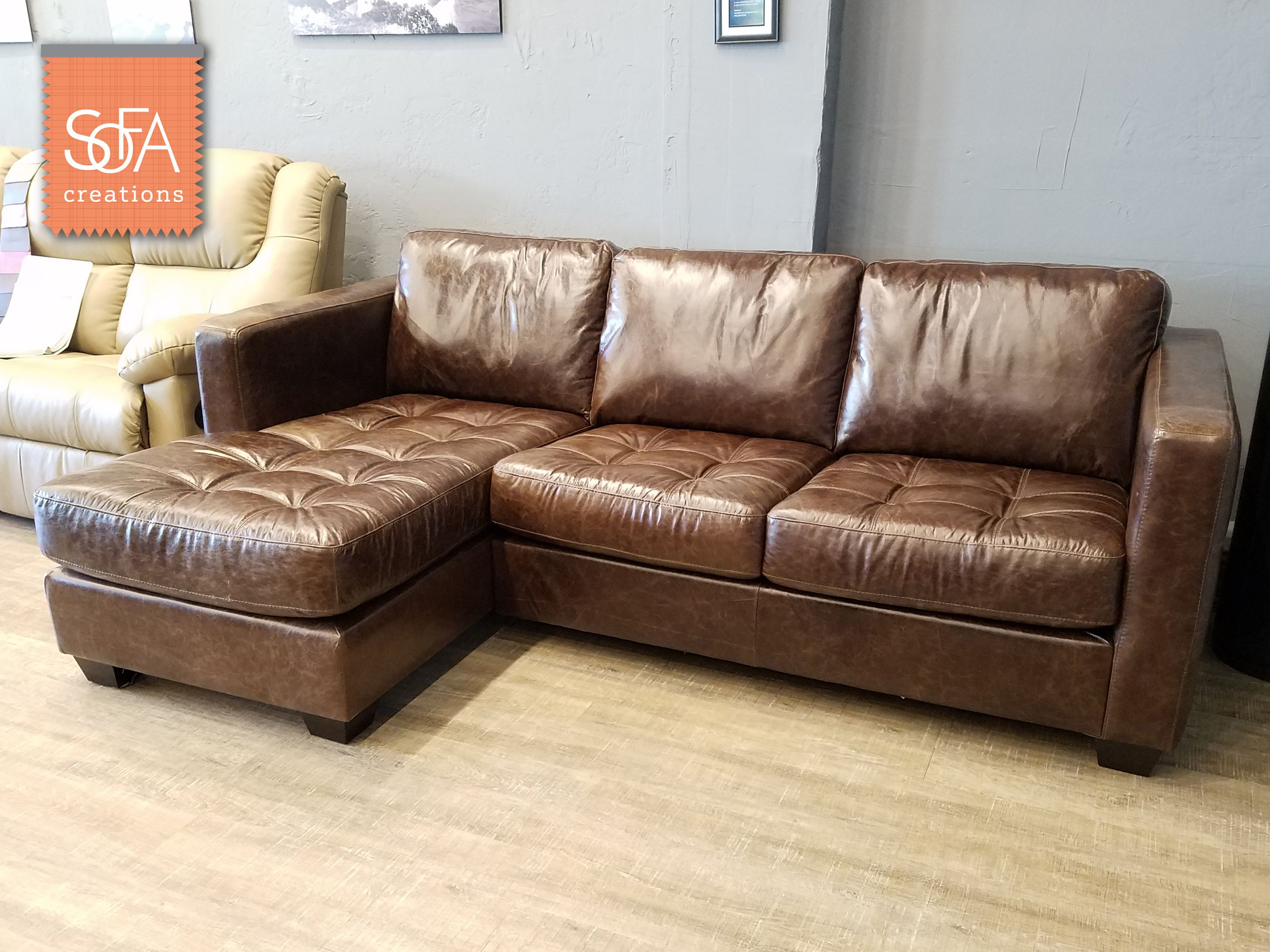 Barrett Top Grain Leather Sectional Featuring A Stylish Tufting