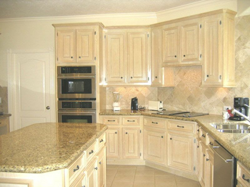 Pickled oak cabinets with granite tops undermount for Bleached wood kitchen cabinets