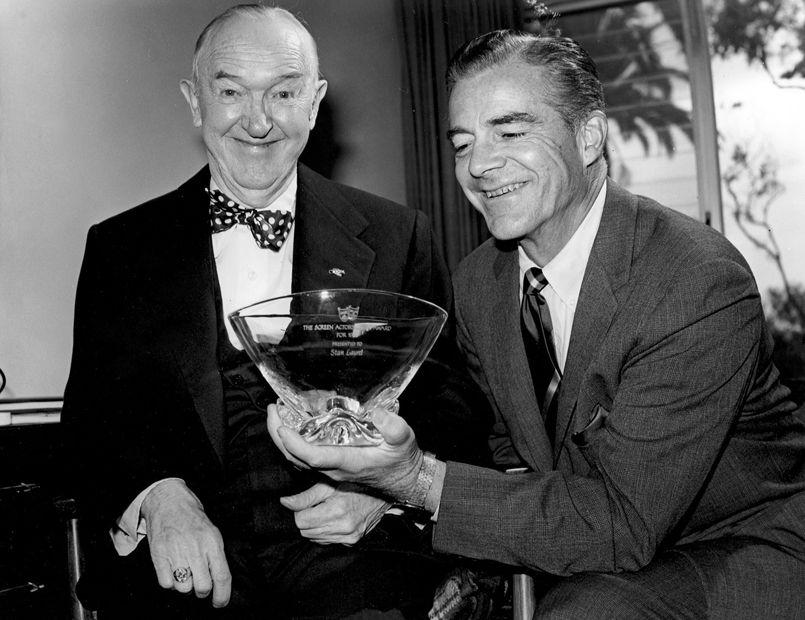 Stan Laurel receives from Dana Andrews the Screen Actors Guild Life Achievement Award