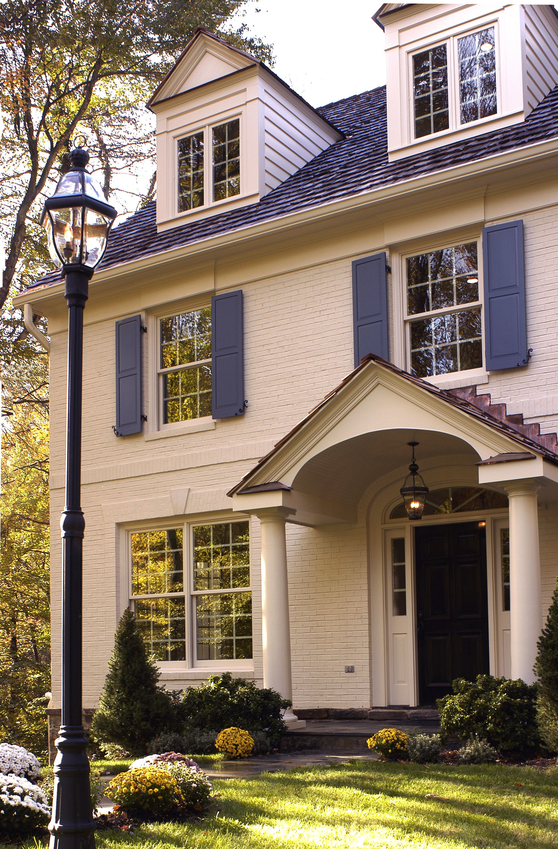 Colonial House White Siding Stone Brick Blue Shutters