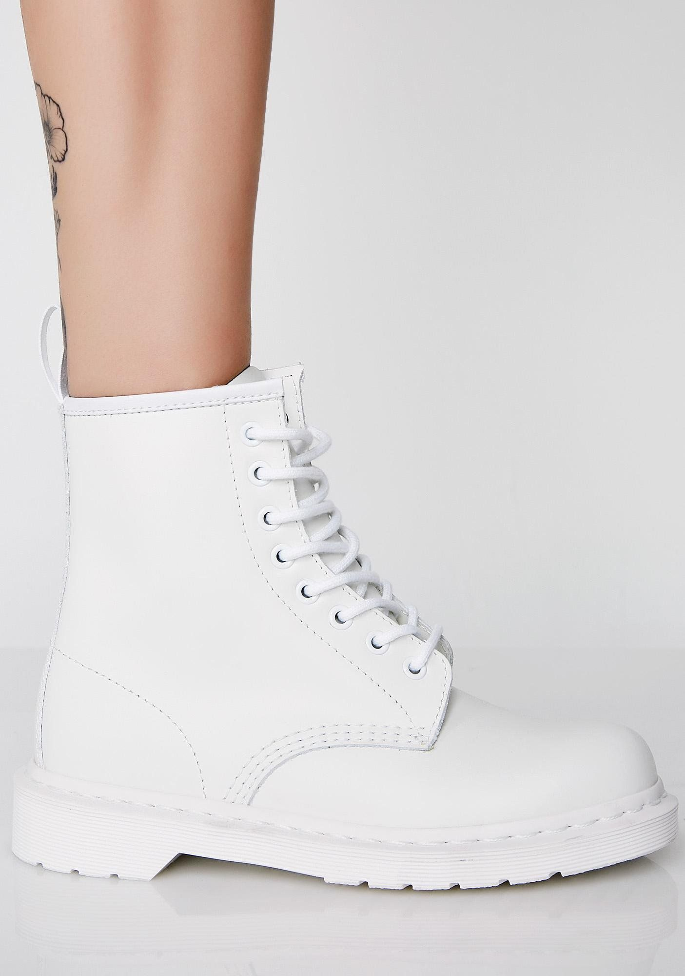 c15ea849b Dr. Martens White 1460 Mono Boots cuz you're so fresh N' so clean. These  combat boots have thikk soles, a pull tab on the back, and lace-up front  closures.