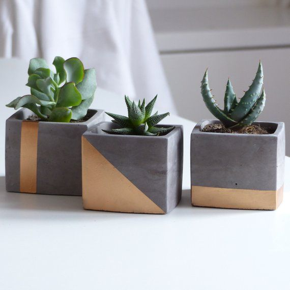 Trio of copper concrete planters with drainage holes is part of Concrete planters - IDandco France