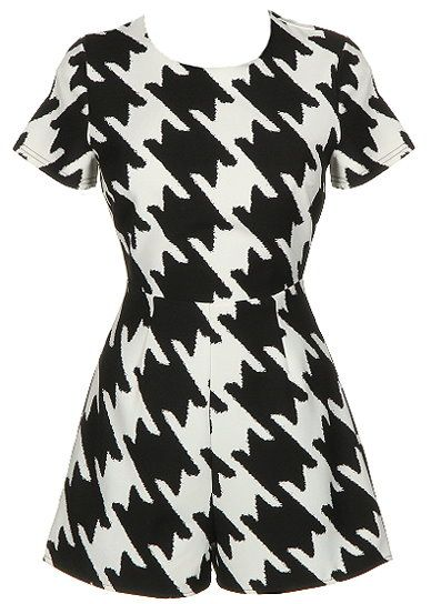 Houndstooth Romper: Features easy short sleeves, on-trend monochrome houndstooth print on both sides, centered rear zip closure, and super cute romper shorts to finish.