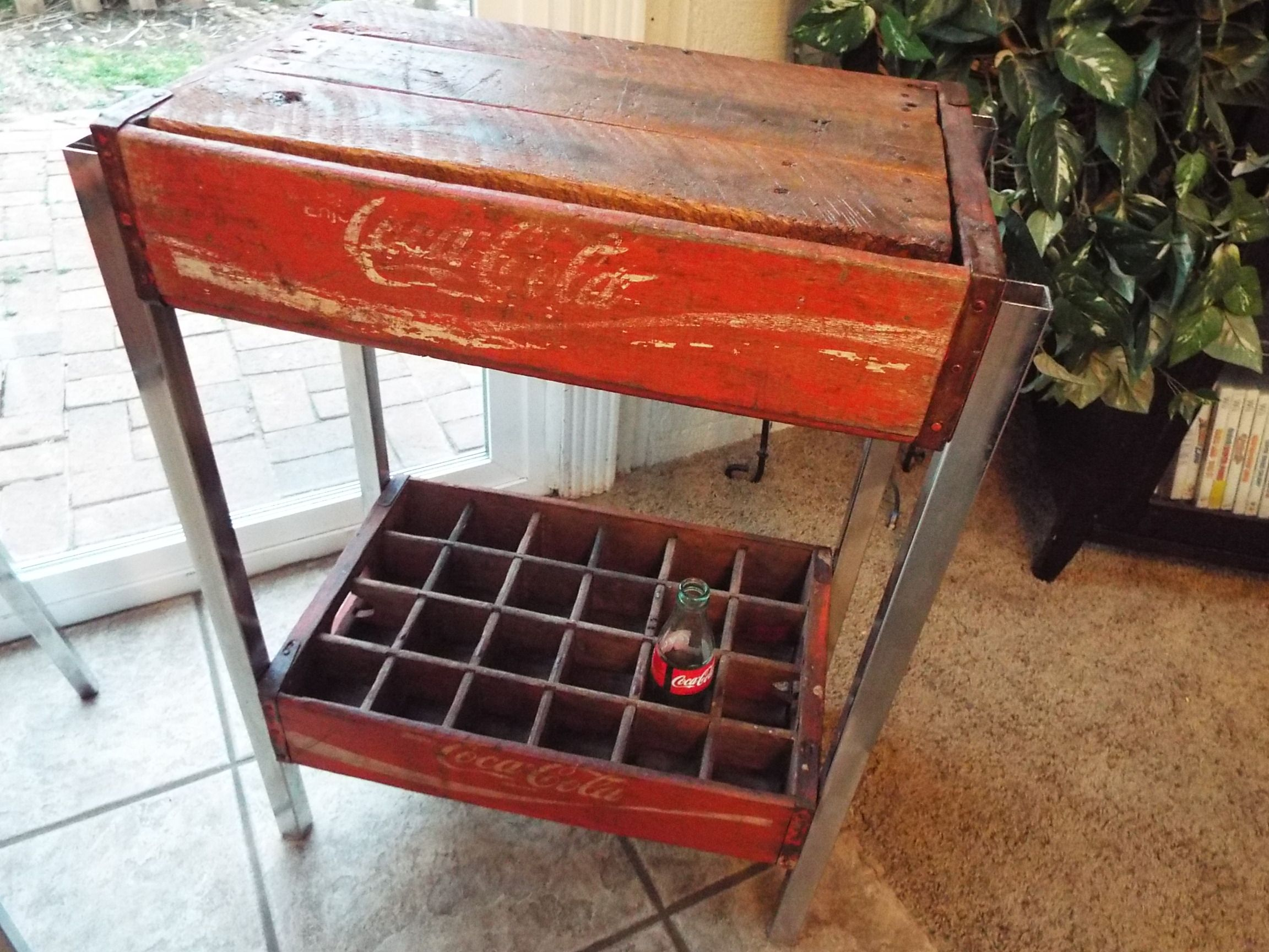 2 old coke crates made as an end table with lid for books