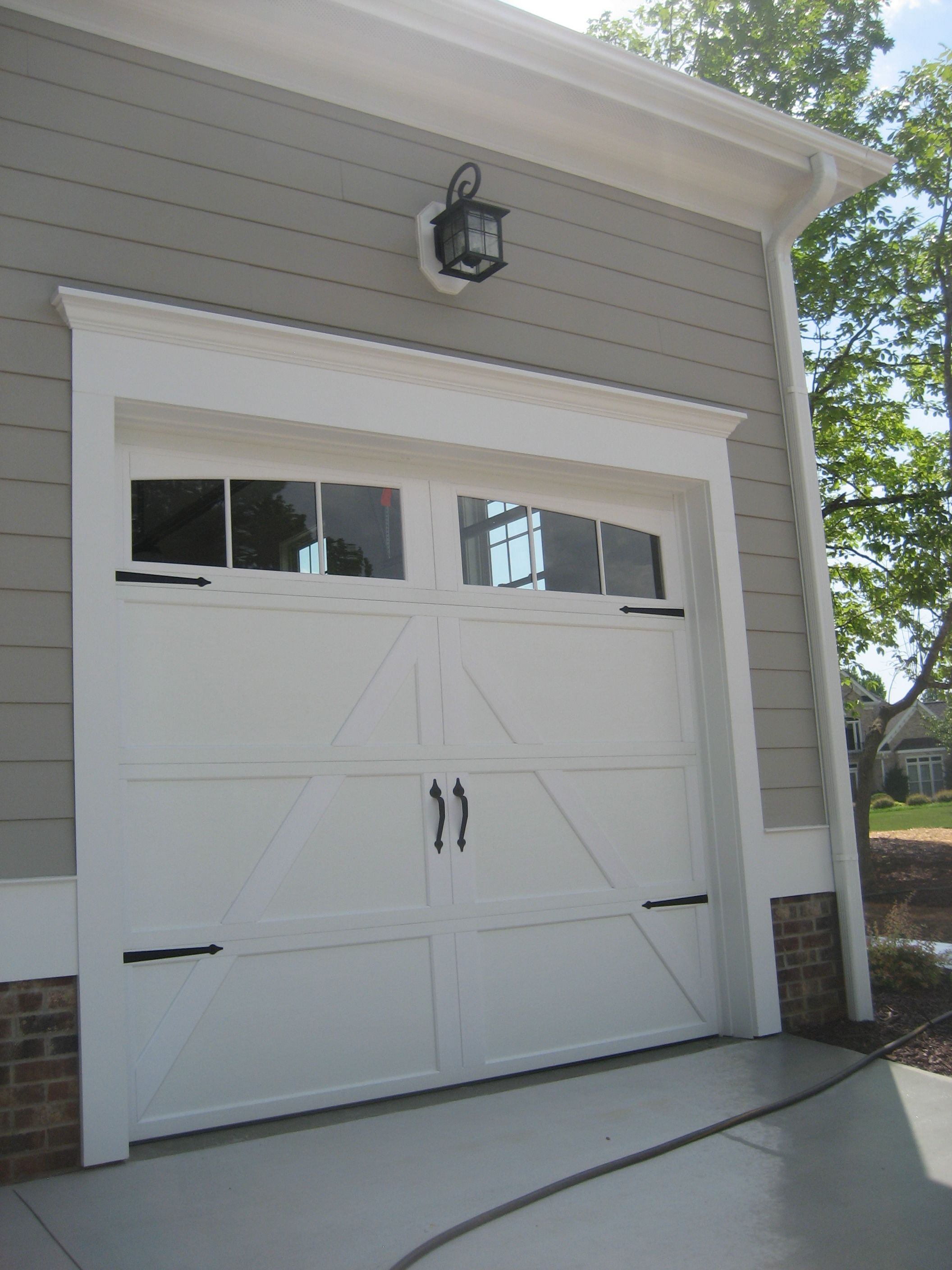 Add trim to garage doorAdd hardware to you boring garage door to give it a quick update