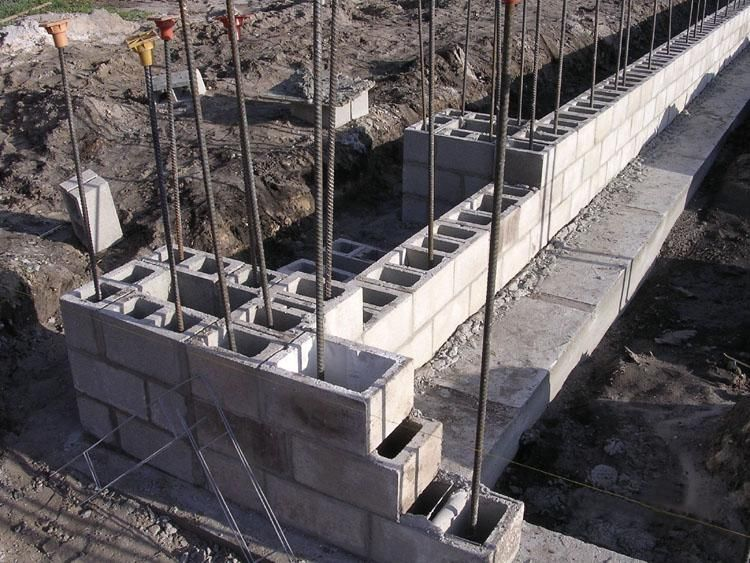 Retaining wall footing rebar cinder block google search for Block wall foundation