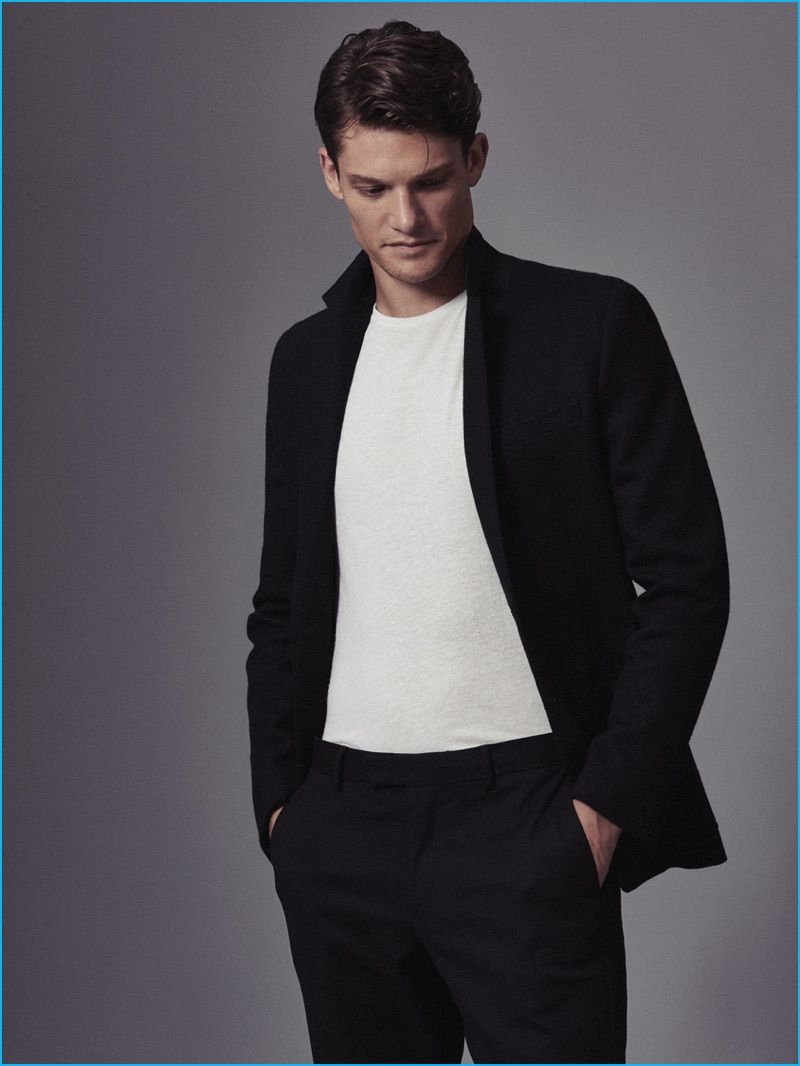5d72fd246ae Danny Beauchamp goes semi-casual with a suit and crewneck t-shirt from Reiss .