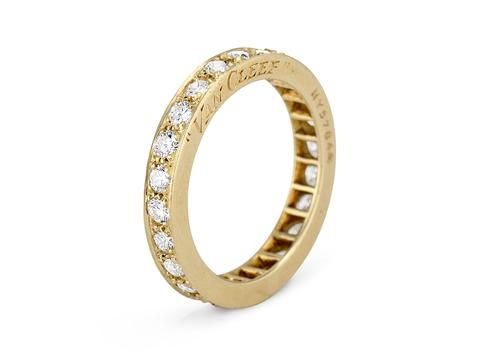 A rare find in this Art Deco eternity band set with 24 transitional-cut diamonds weighing approximately 1.10 carats total and set in 18k yellow gold. Signed Van Cleef & Arpels and numbered 511308-26 and NY57844. 3.2mm width.A special band indeed! Thisexquisite example of Van Cleef & Arpels is a rare yellow gold Art Deco find!Diamond and gold mining has caused devastation in areas such as Africa, wreaking havoc on delicate ecosystems and communities. Choosing to go vintage, you are eliminati
