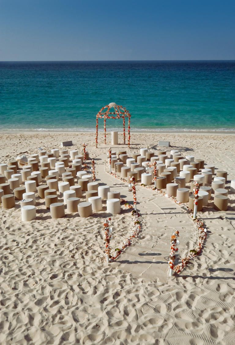 Wedding decoration ideas at the beach   OvertheTop Wedding Ideas  A Curved Wedding Ceremony Aisle