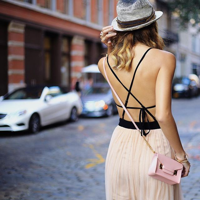 Shot this backless @itsnbd beauty at SoHo with @aagdolla before I left for Calgary. Anyone else has a problem aligning your ribbon tie to the centre when you have to tie them behind your back?  #NellieInNYC by nellielim
