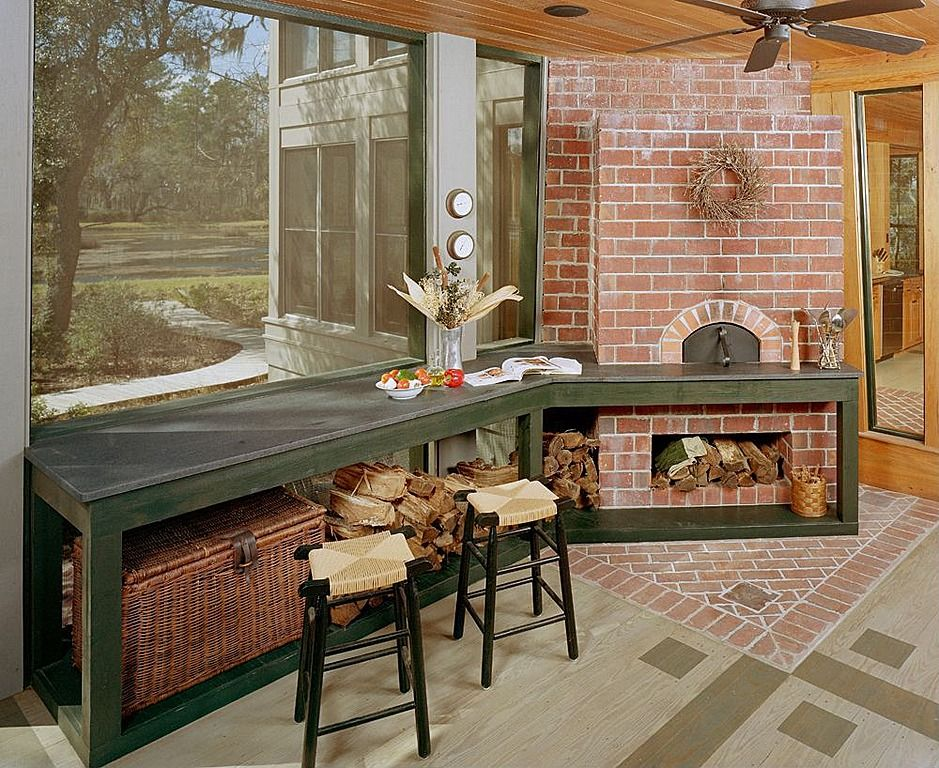 Rustic wood stove + wicker stools = country cooking done right.
