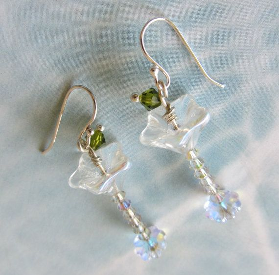 ITS 5 OCLOCK SOMEWHERE!!!    These darling martini glasses with a cute Swarovski crystal olive are approximately 1-1/2 long. The bottom is a Swarovski margarita crystal, the stem is made up of Swarovski bicones, and the cup is a Czech flower bead. All the crystals twinkle in the light. They sway prettily from sterling silver earwires.    The earrings will come in an organza drawstring bag for gift giving, and First Class mail shipping is free in US.