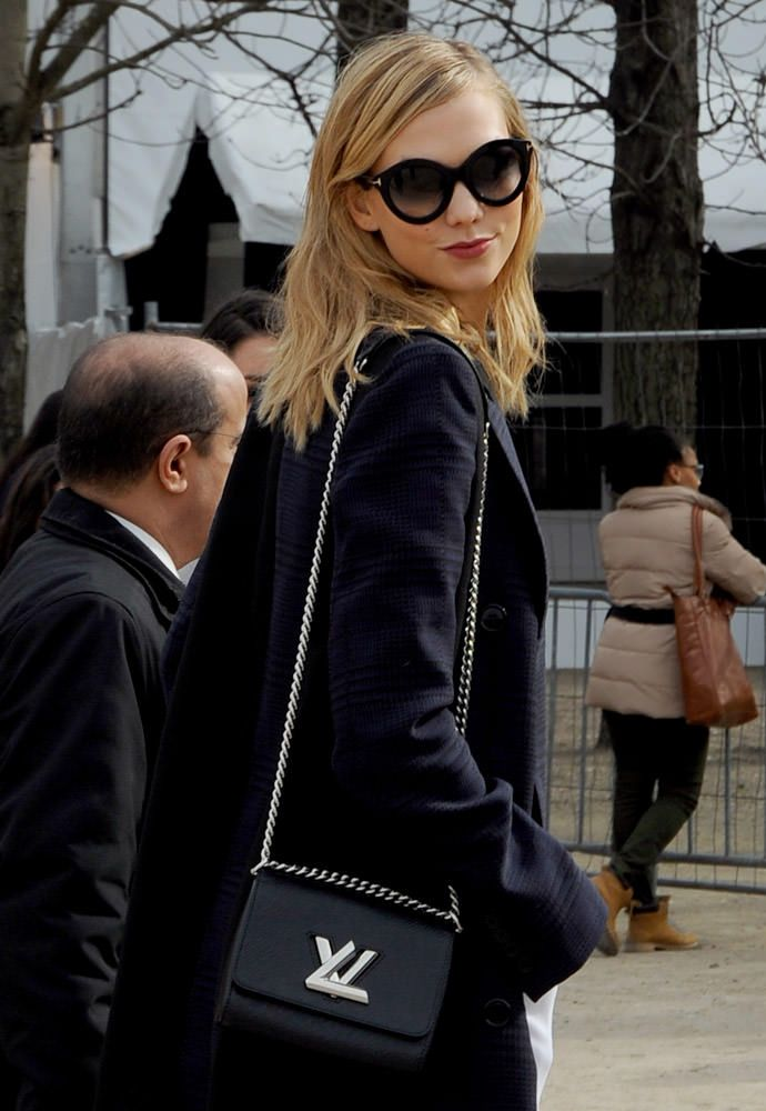 6a134682177 The Louis Vuitton Twist Bag was spotted on Karlie Kloss during Paris Fall  2015 Fashion Week  PFW - via Purseblog.com