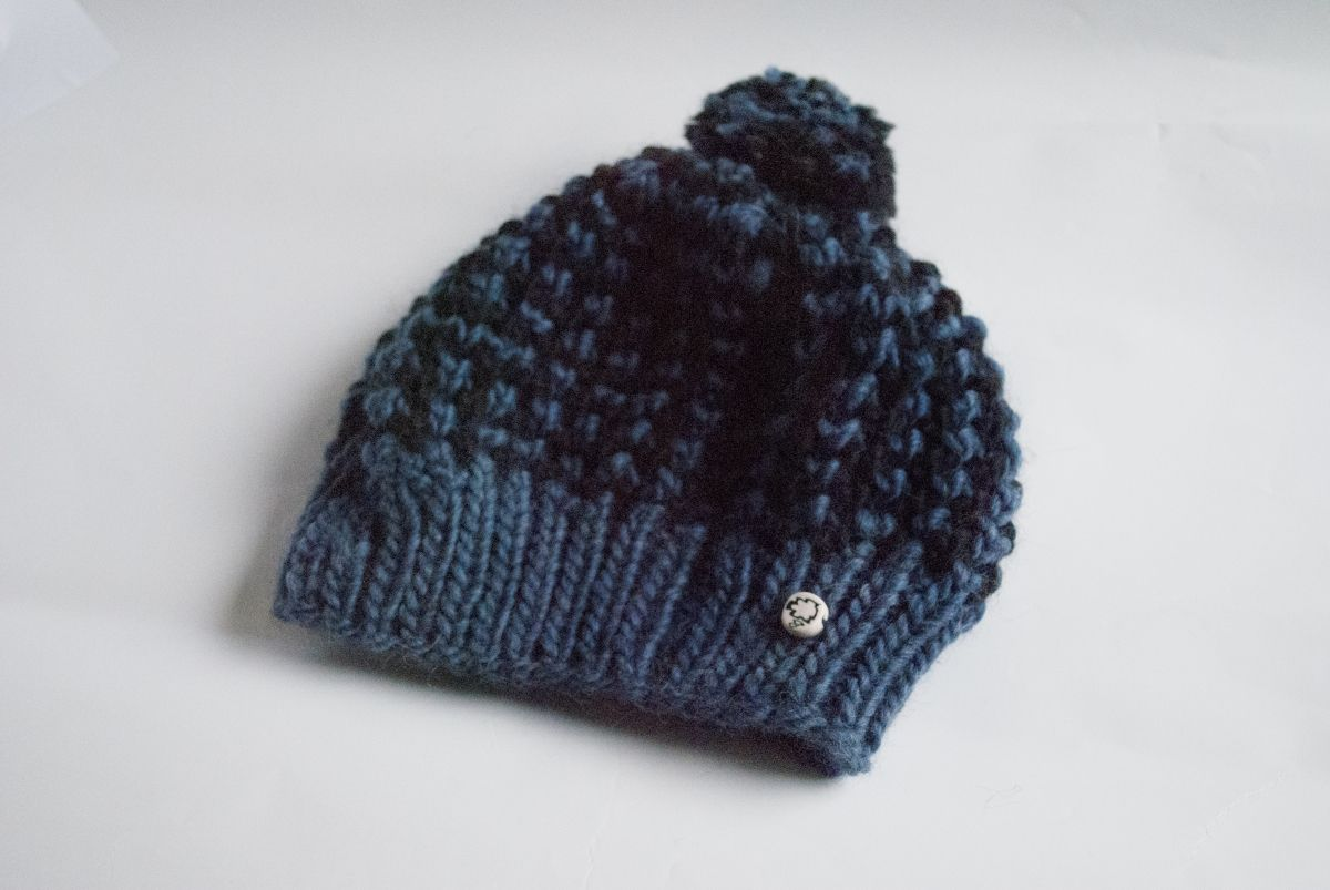 71ca44fd578 Actually manly pom hat is a handcrafted grungy beanie for all the handsome  guys out there