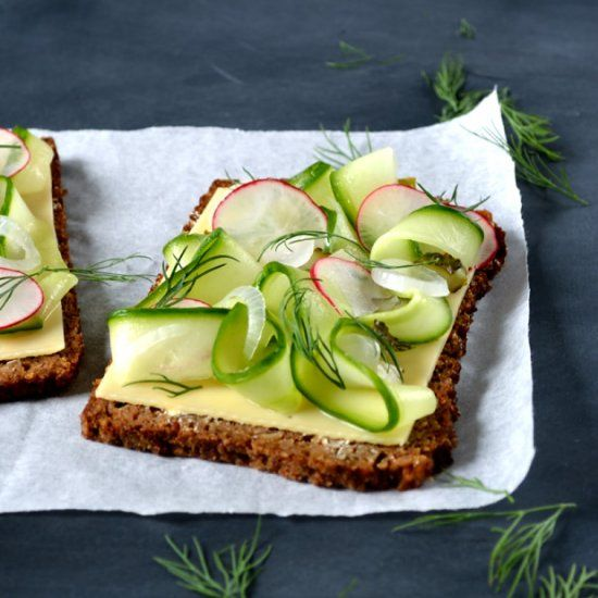 This Scandinavian Rye Smörgåsbord is a feast of scandi flavors - pickles, dill, cucumber, radish and continental cheese. A tasty treat.