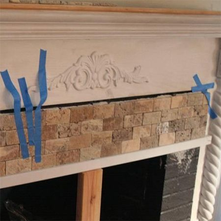 add stone mosaic tiles to fireplace front