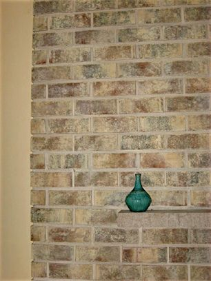 Brick Transformers artistically refinishes and stains existing interior & exterior bricks to new colors. An affordable altenative to resurfacing or refacing.