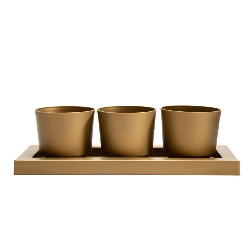 Spruce up any open space inside your home with this beautiful set of 3 planters and matching saucer tray. Crafted from high-quality durable plastic, this set is perfect for showing off succulents, herbs and other smaller plants. Each planter includes a pre-drilled hole in the bottom for drainage. No worries about any water spills because all 3 planters snap securely into the matching saucer tray. This modern planter set is easy to move and versatile for displaying both indoors and outdoors. Tota