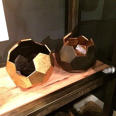 Accessorize your space with the antique gold Polyhedron Vase featuring a geometric design that brings an ambient outdoor energy inside. Ideally suited for displaying flowers and plants, this decorative container will add warmth and charm anywhere in your home. *Choose size below.