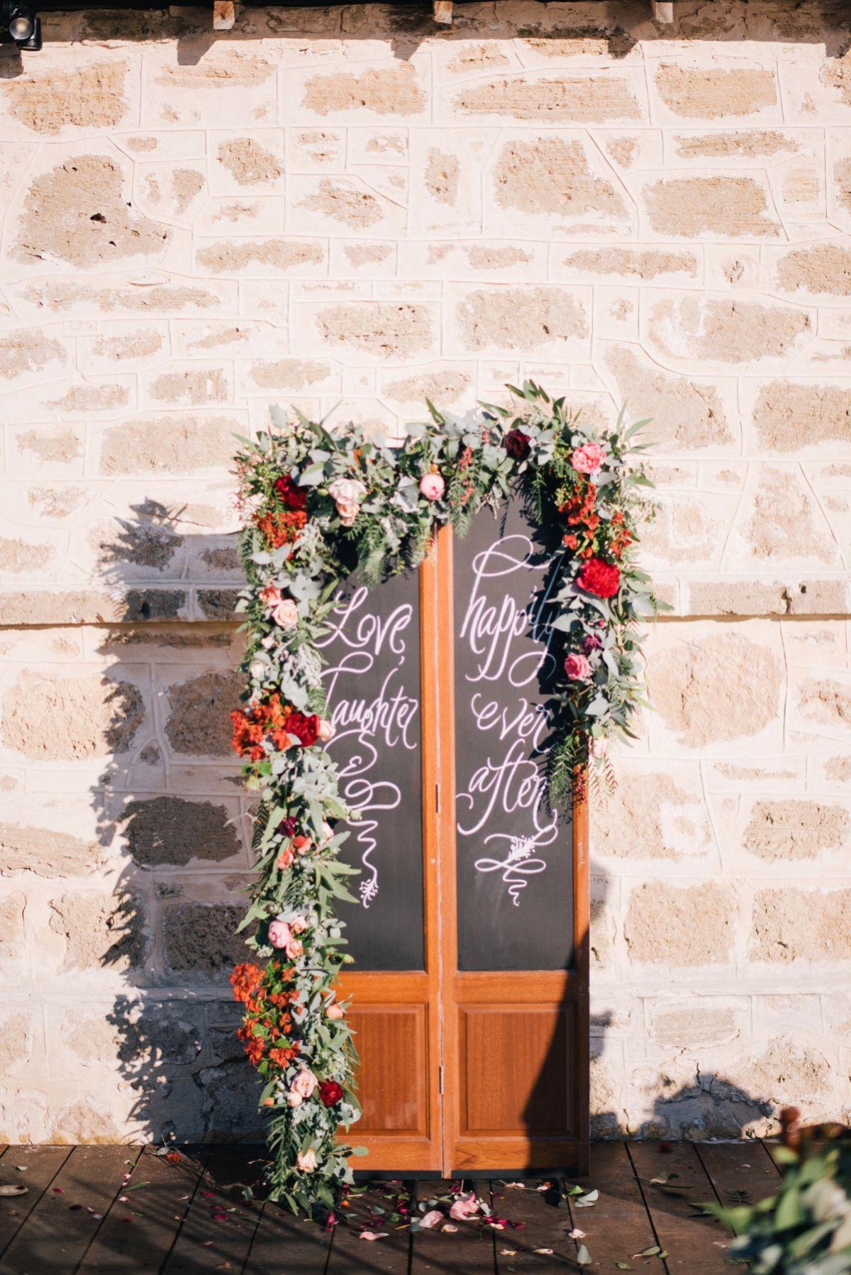 Kidogo Arthouse Wedding Wedding ceremony backdrop