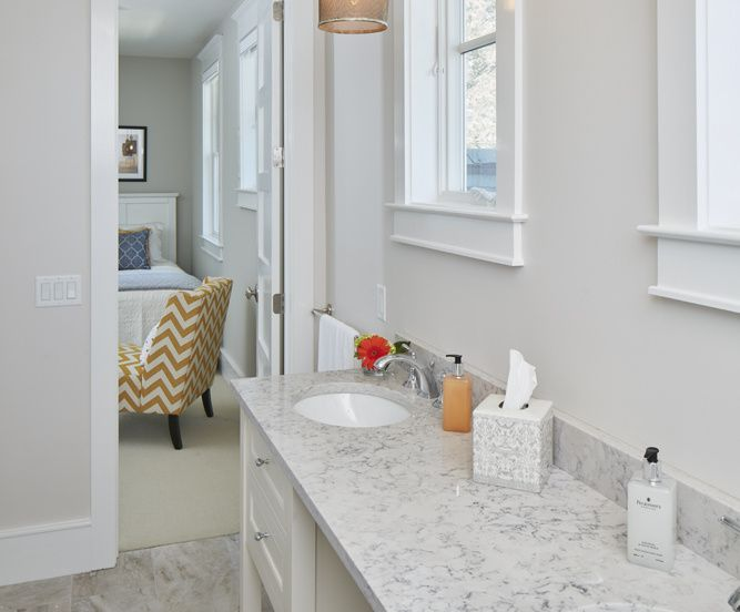 This gorgeous guest room bathroom's vanity has double sinks so guests feel pampered.