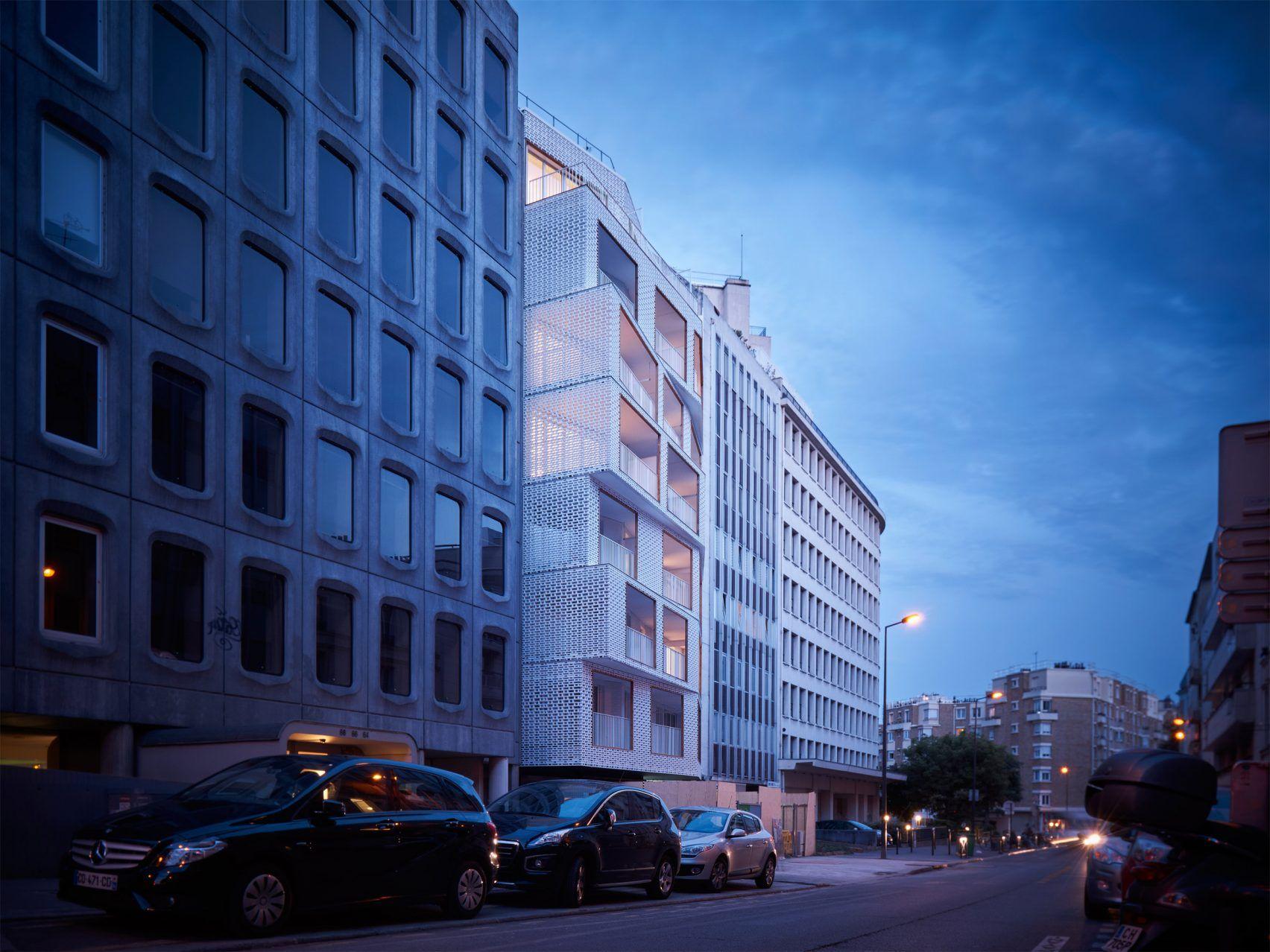 Odile Guzy Architectes adds white lattice screens to Paris apartment block