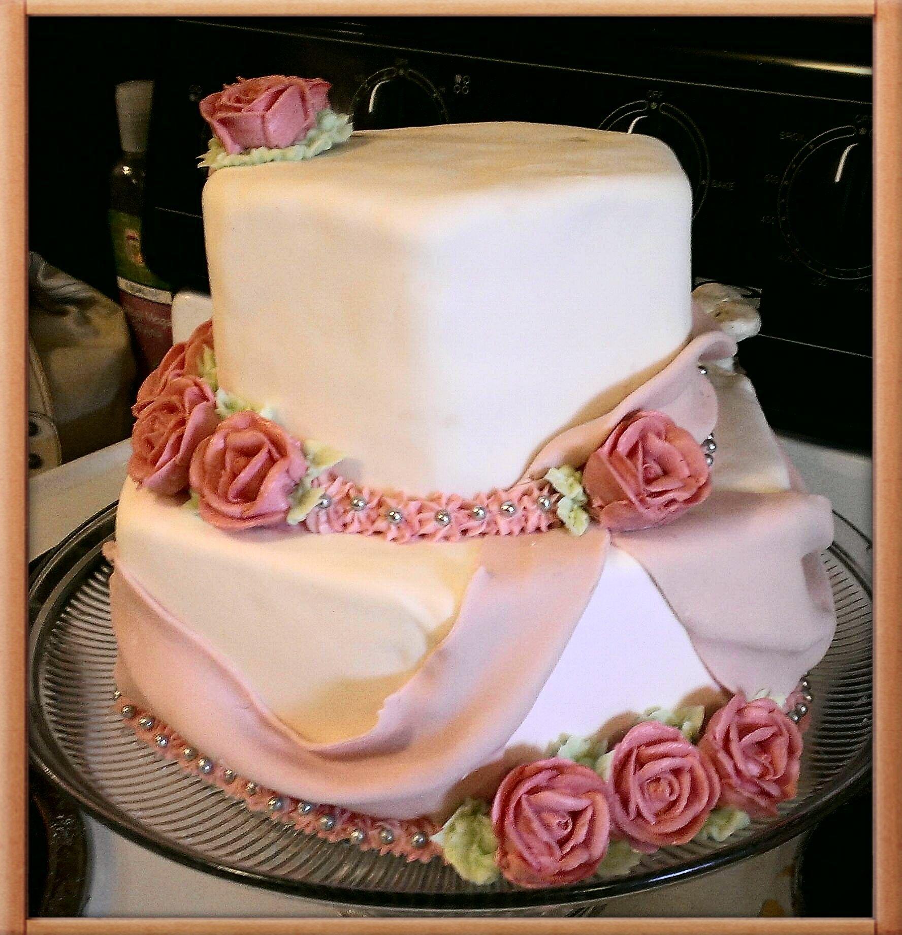 vanilla and chocolate cake with vanilla butter cream and marshmellow fondant