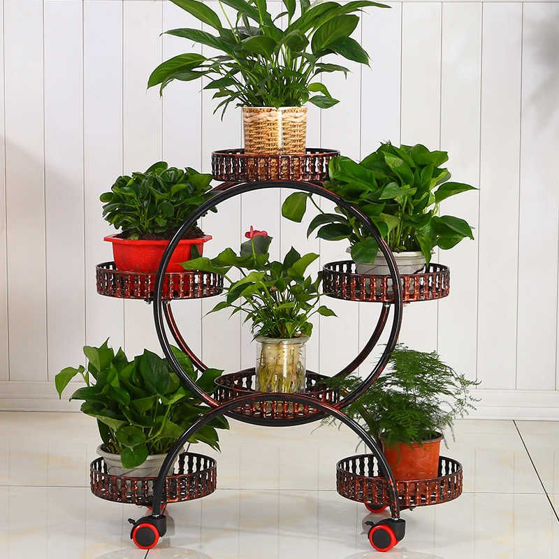A cheap portable flower stands with wheels metal plant