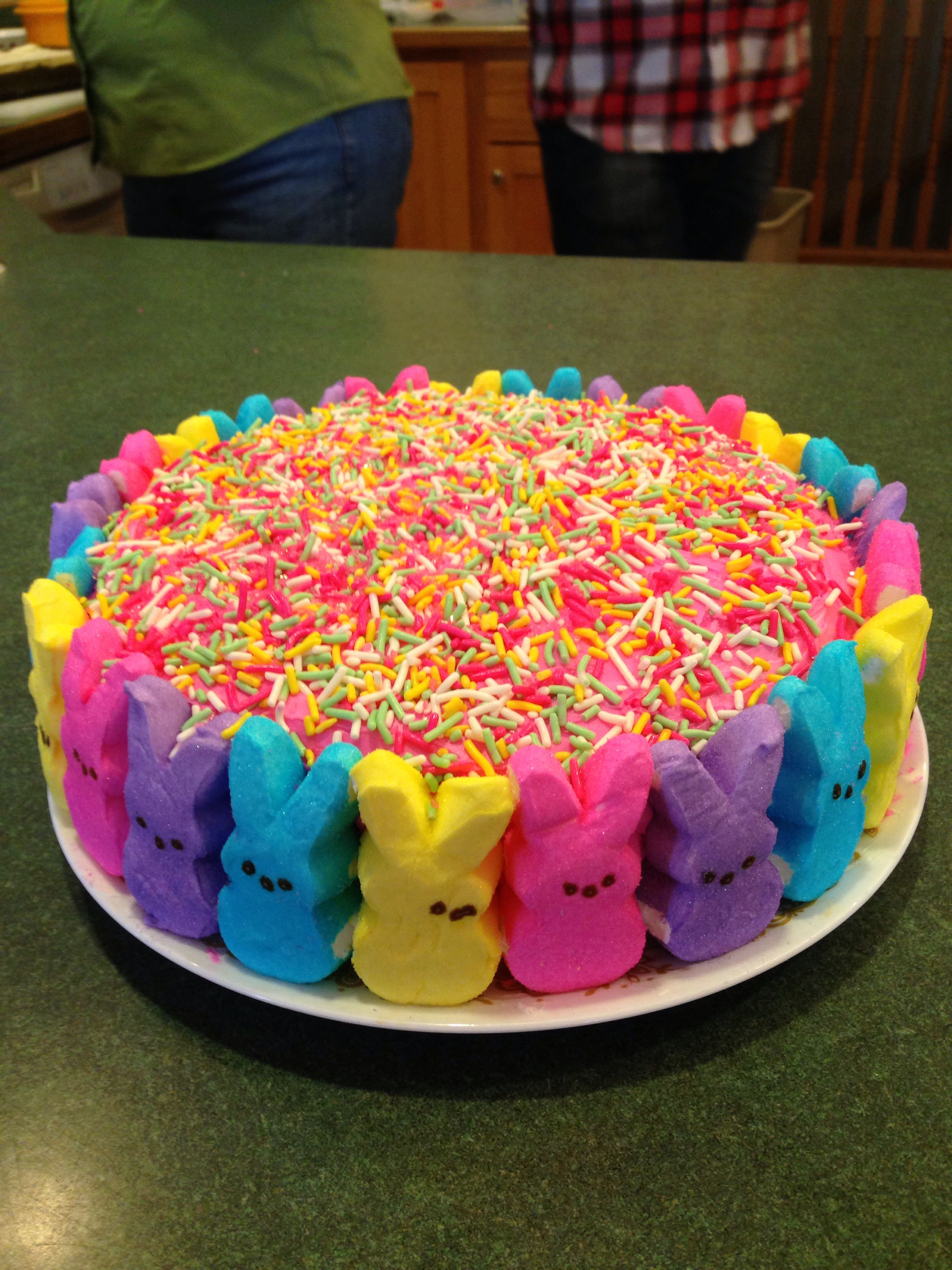 "Peep cake!!   ...................... Make a cake!! Add any color frosting,  Add peeps in a orderly pattern Add sprinkles on top You have ""hopefully"" made a wonderful looking easter cake!"