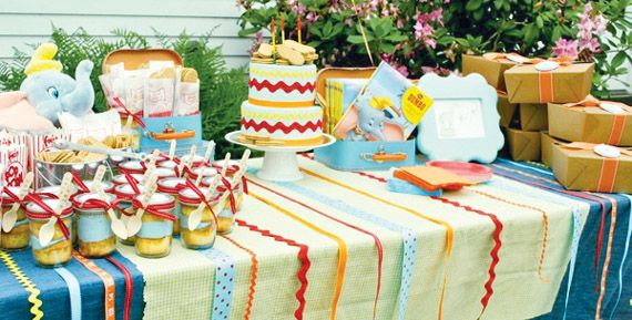 This table is for a dumbo party but I love the idea of using ribbon to add interest to the table. Buy lots of different colors and patterns. Adds interest to the dessert tablescape.