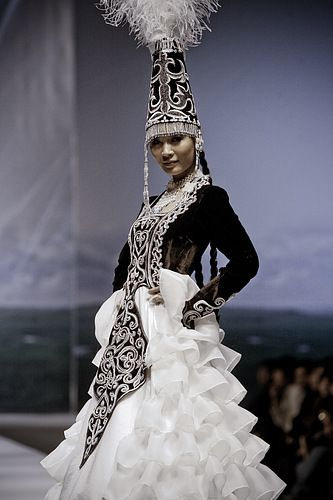 white and black color Kazakhstan traditional wedding dress 2014, because Kazakhstan border between Russia and Chinese , so their dress is influenced a lot from 2 big countries