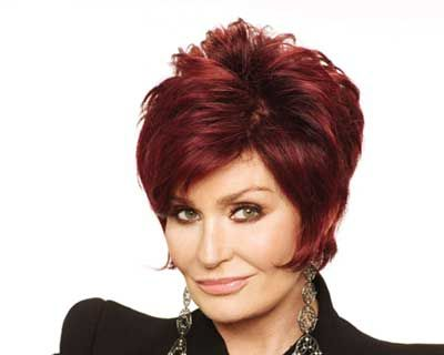 I really do like Sharon Osbourne's hair. Think it's very appealing. Wonder if I could pull off this short of a cut and then also the redI???