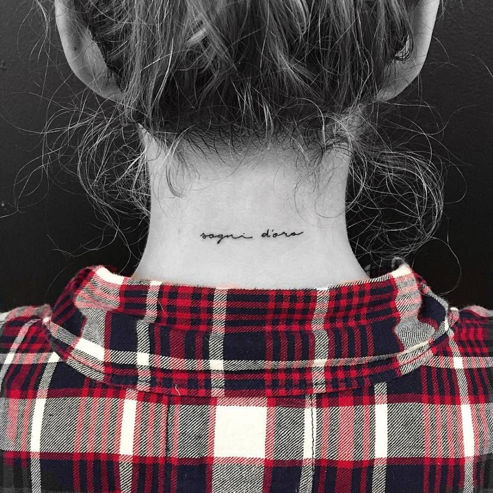 "Back of the neck tattoo saying ""Sogni d'oro"". Tattoo"