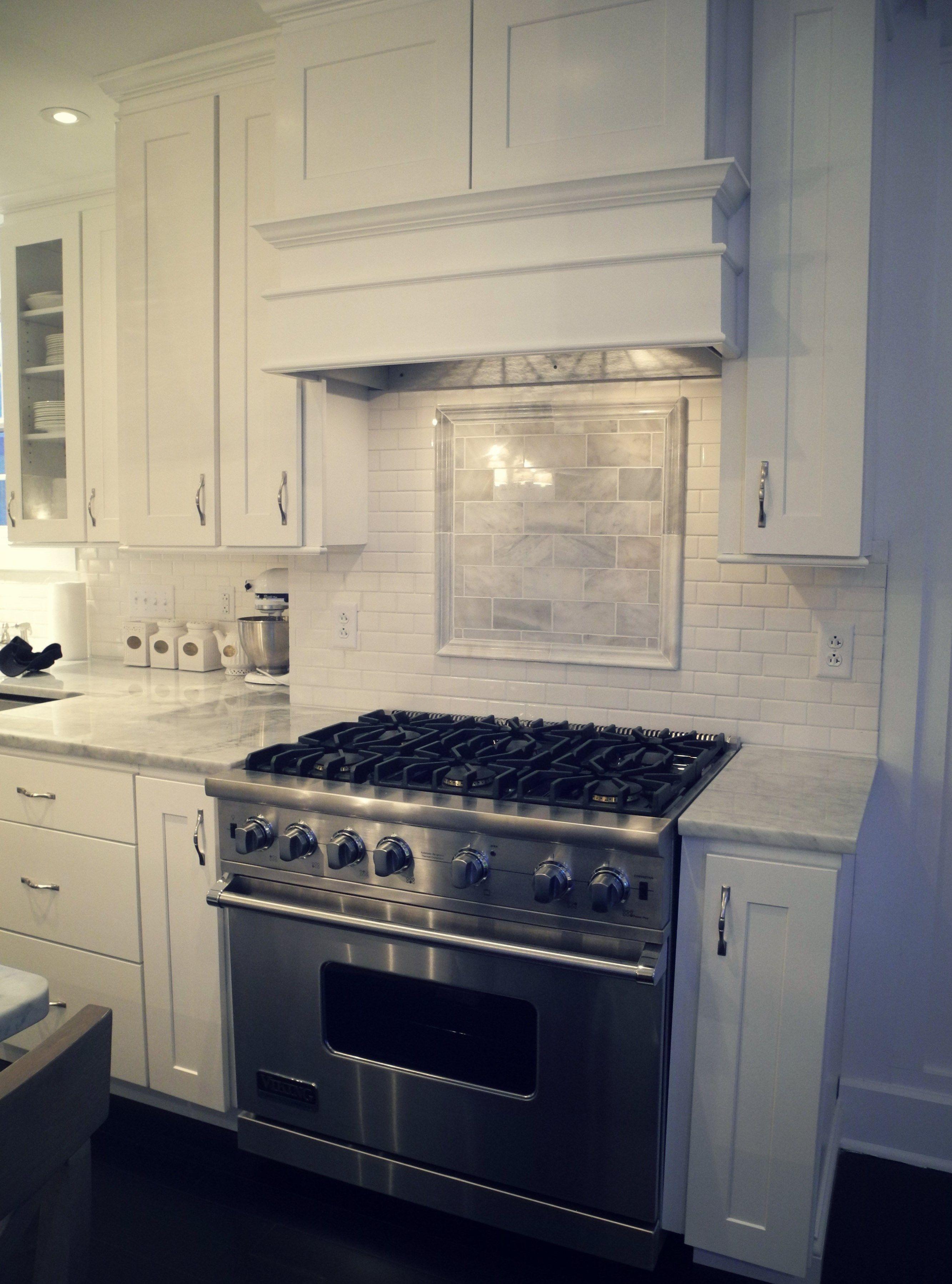 Viking oven, white kitchen, Carrera marble counters