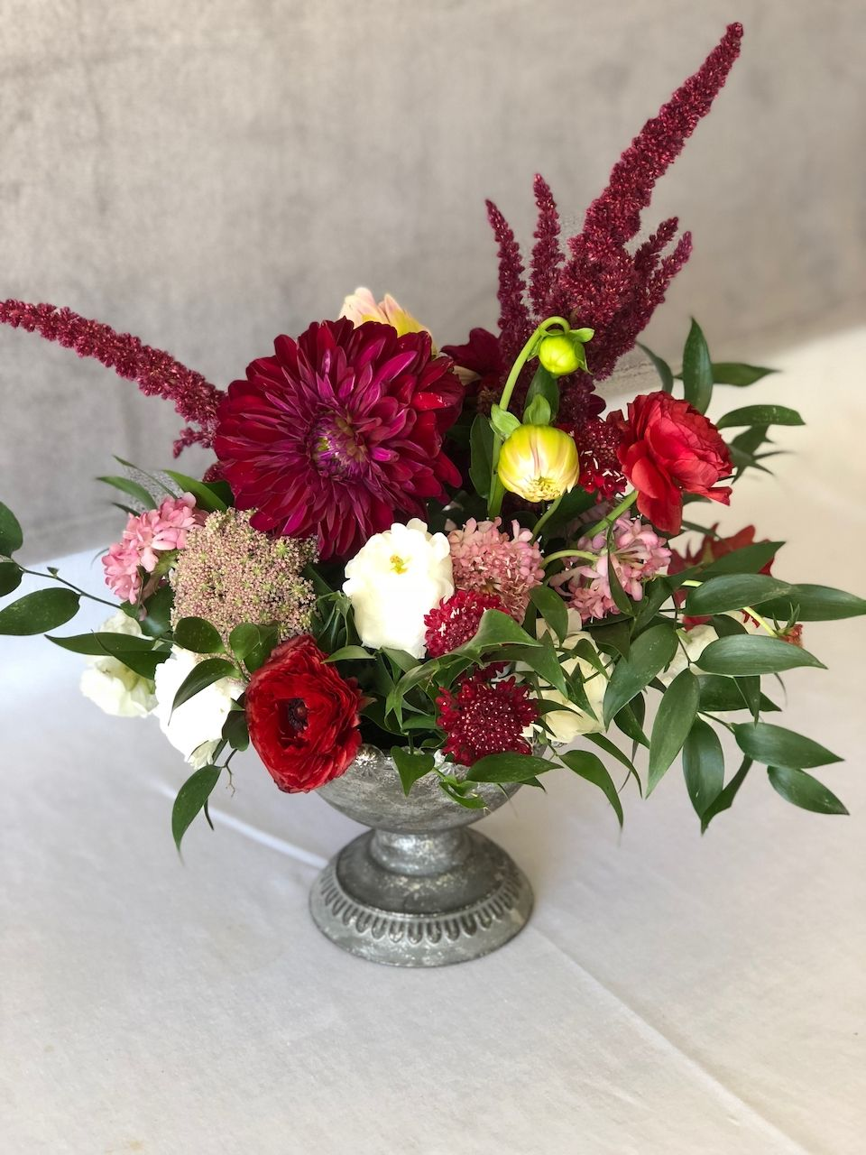This Beautiful Centerpiece with Dahlias and Ranunculus