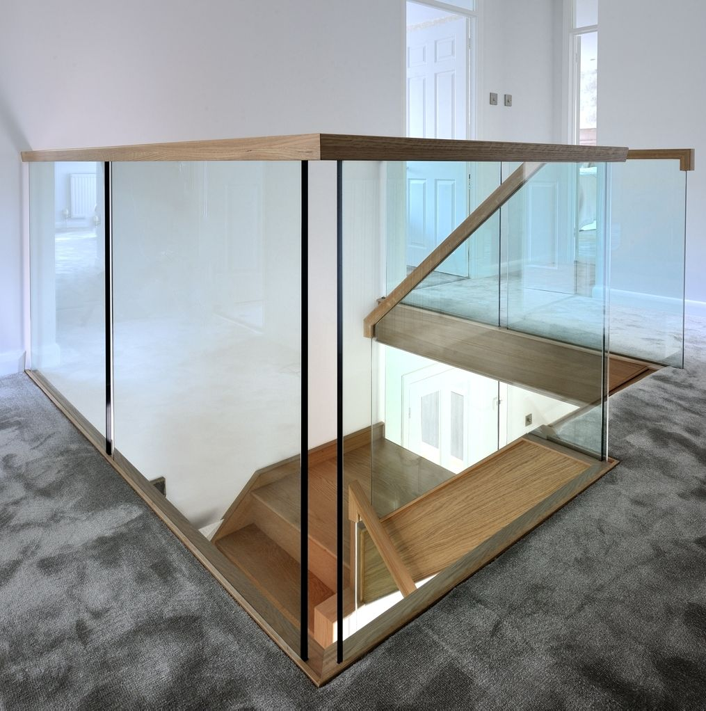 Landing shot of the contemporary, oak and glass staircase ...
