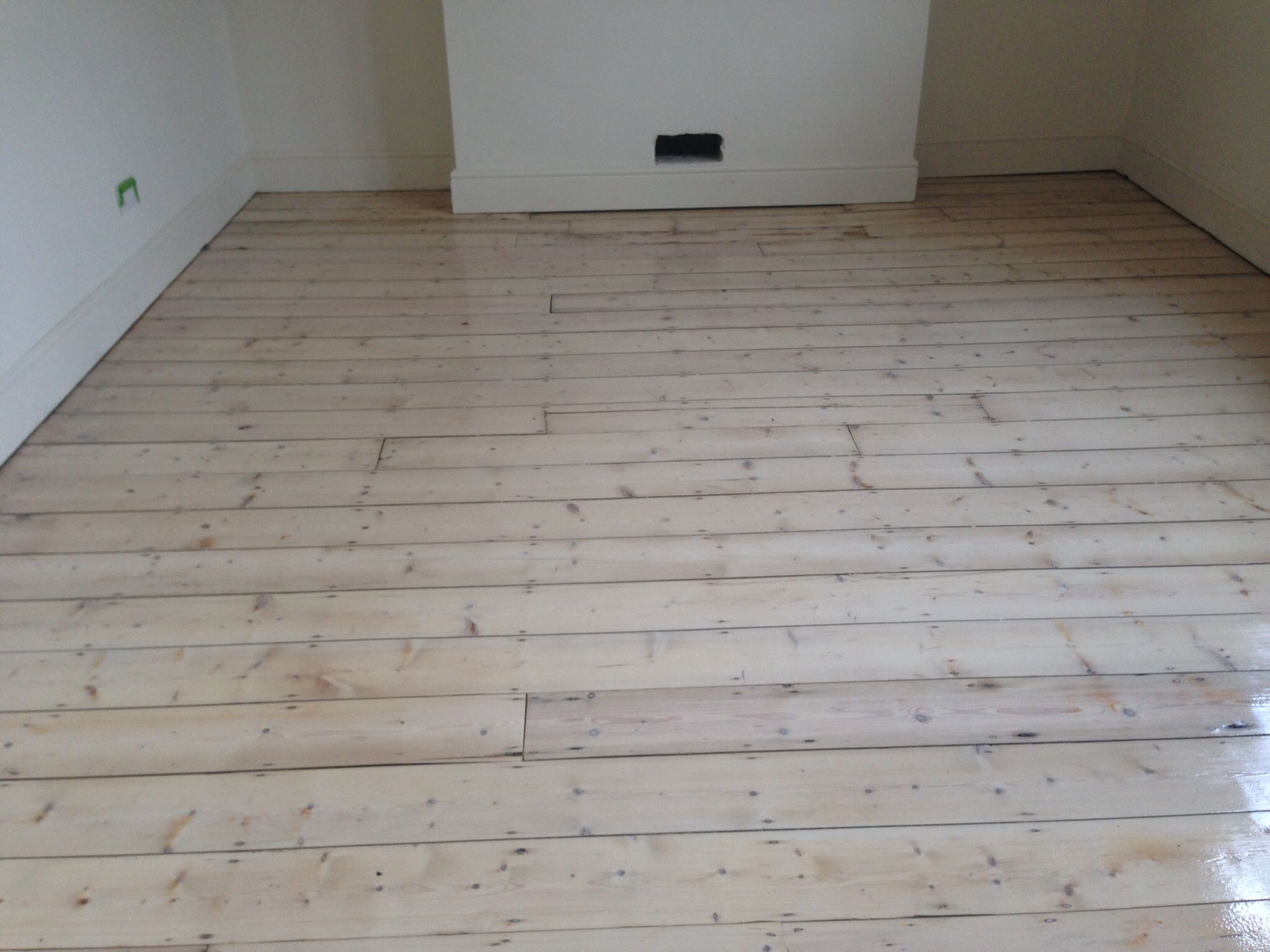 White washed pine floor protected with bona naturale White washed wood flooring
