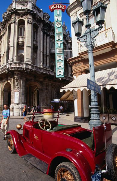 Old American car in front of Hotel Inglaterra by Lonely Planet Images
