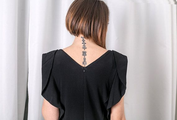 Full body lenght classy jumpsuit in black. The minimalist look in black gives that stylish feel of the item itself, sleeves could be worn multiple