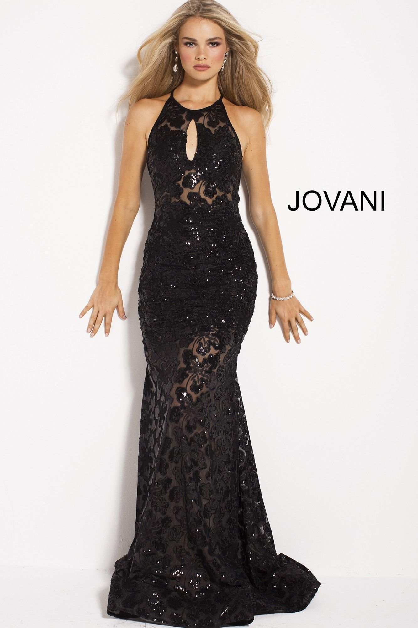 78127bb0 This mesmerizing illusion gown blossoms with a shimmering sequin floral  print. The sheer halter bodice has a high neckline, small keyhole opening  on the ...