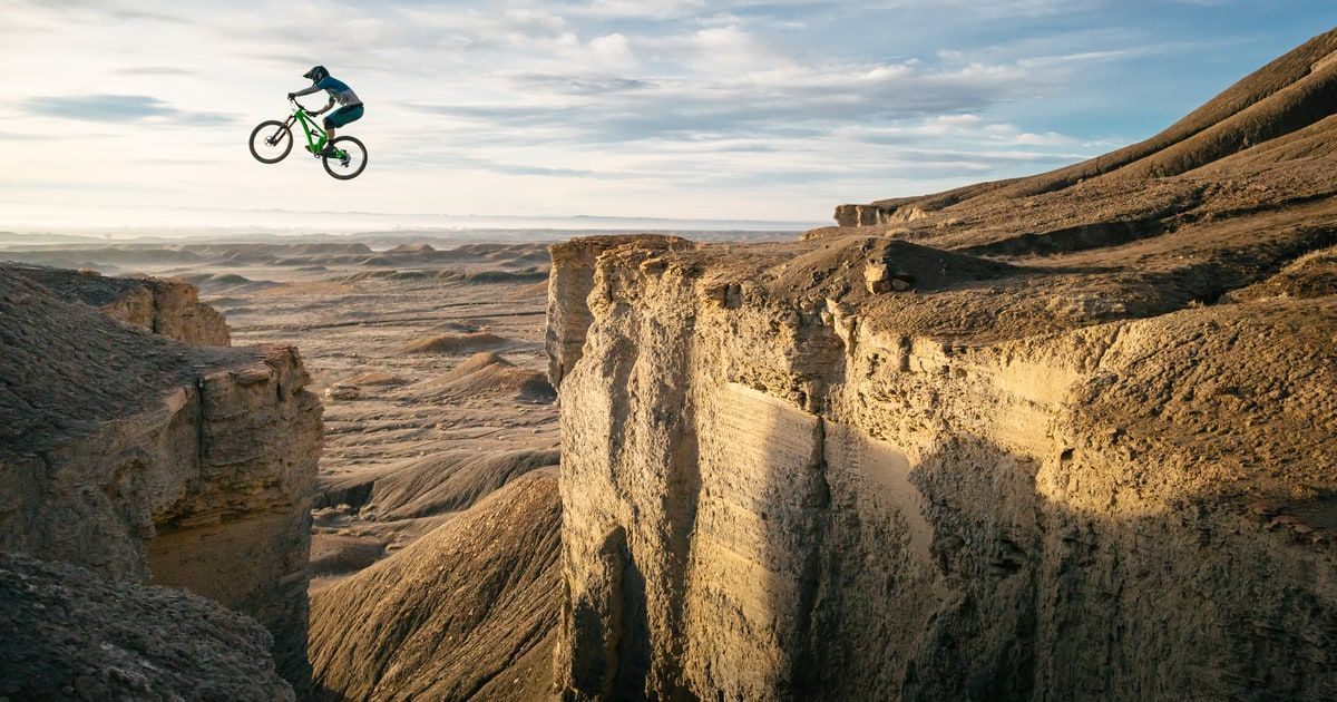 The Shot Yeti Cycles Rider Shawn Neer Closes The Gap Between Two Ledges In The Book Cliffs In Green R Adventure Photography Green River Utah Adventure Photos