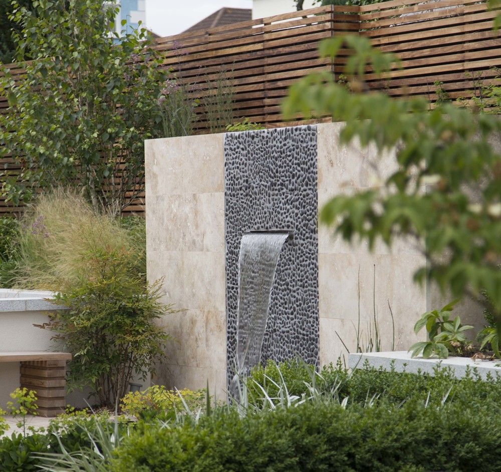water wall garden cascading water wall in travertine and polished black river pebble