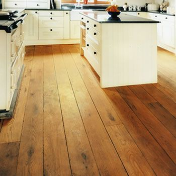 Rich Wooden Floors, Pale Units And A Dark Work Surface. Looks Good, But How  Practical Are Those Floors In A Kitchen?