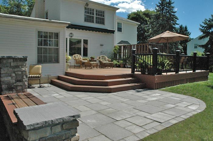 Patio And Composite Deck With Lighting In Steps