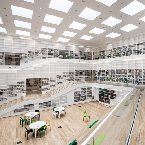 Stairs spiral around interior of Adept's Dalarna Media Library in Sweden