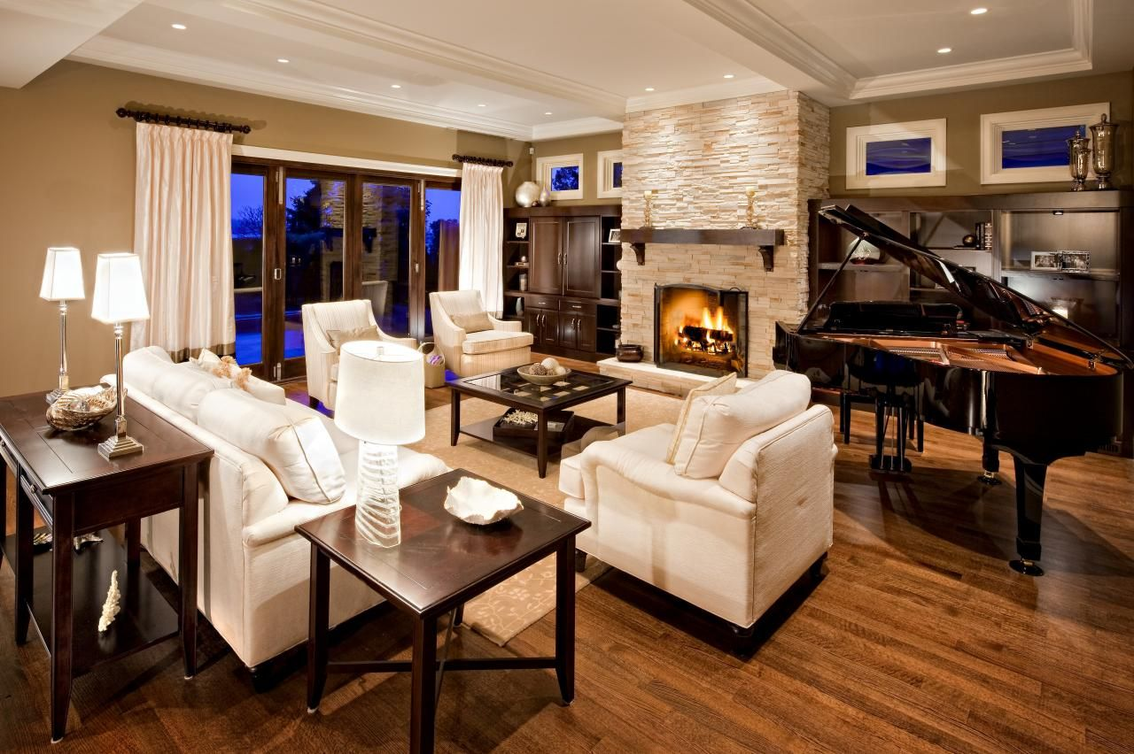 This Beautiful Living Room Features A Grand Piano Cultured White Stone Wood Burning Fireplace And Pl Piano Living Rooms Livingroom Layout Elegant Living Room