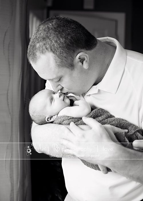 Newborn picture of dad kissing baby amy ro photography newborn portraits ri